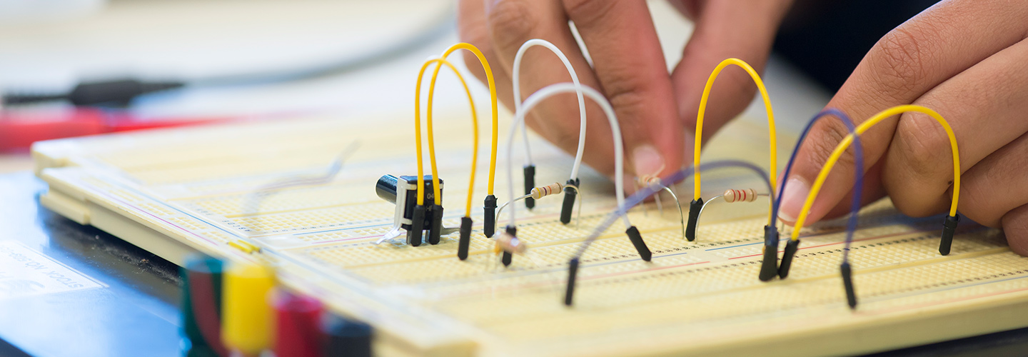 Student working with components on a breadboard