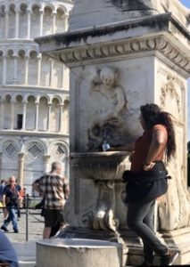 Student filling water bottle outside the leaning tower of Pisa