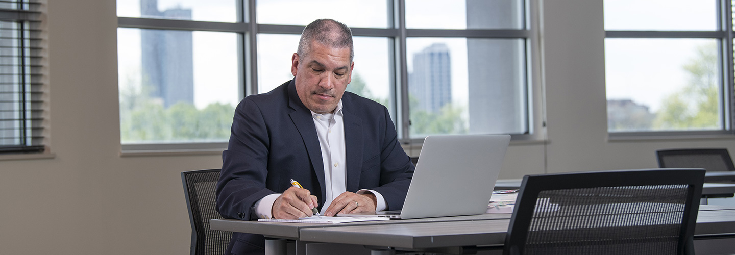 doctoral student working on a laptop
