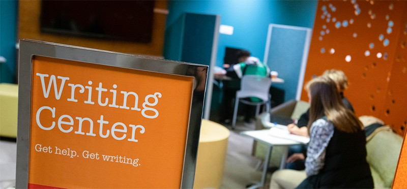 Students seeking help in the writing center